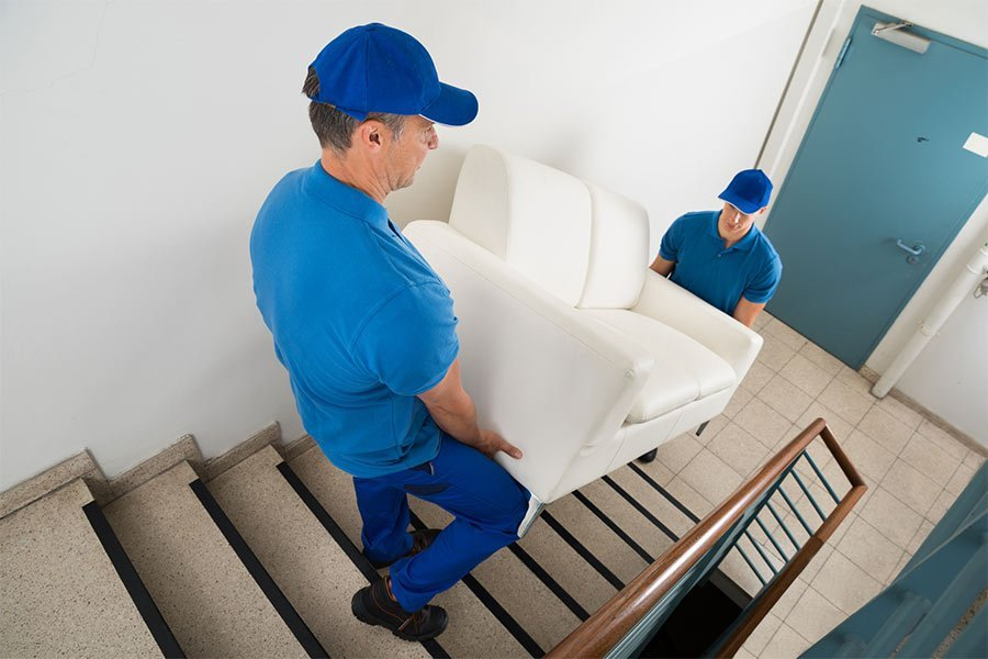 panther removals and storage two movers carrying sofa on staircase