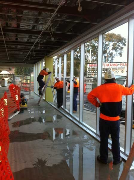 workers installing floor to ceiling windows