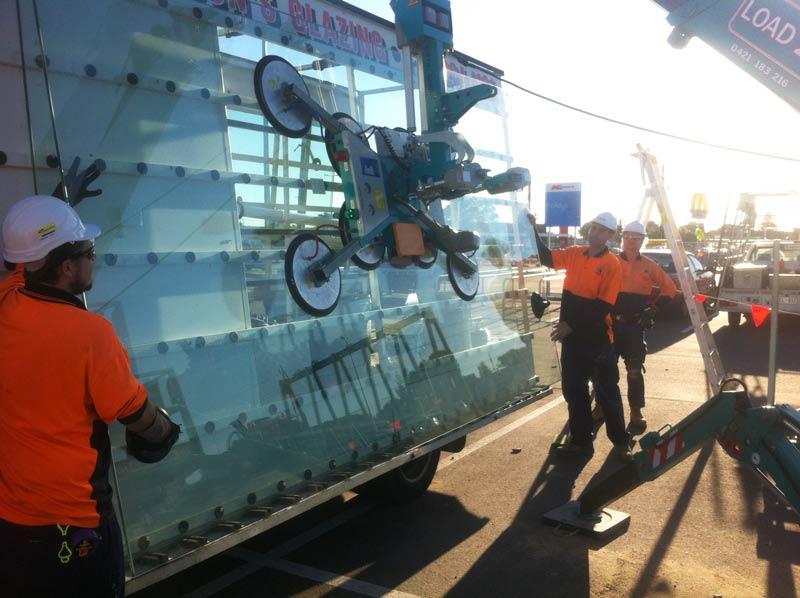 glaziers installing glass