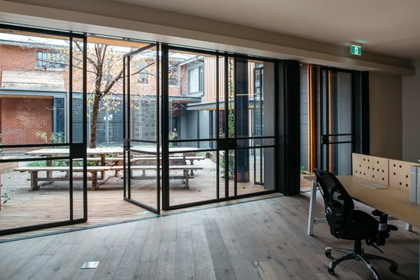 glass doors opened to courtyard