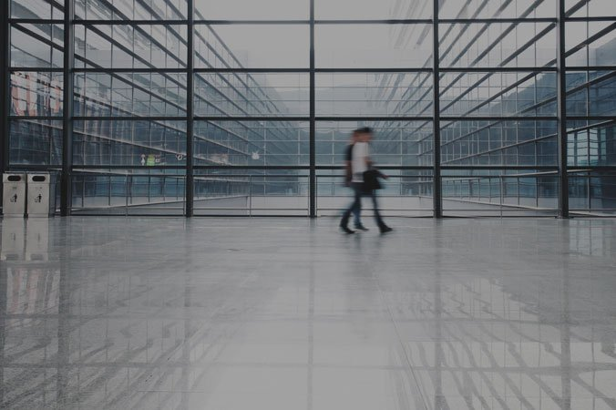 People walking through a clean office atrium