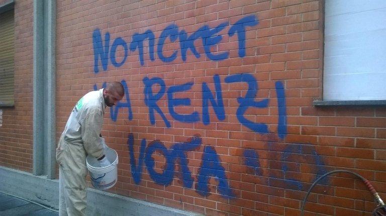 eliminazione graffiti sul muro