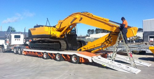 Earth moving equipment for sandblasting and coating