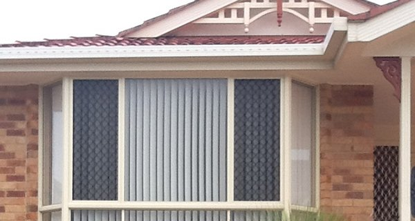 elegant blinds and awnings house window with vertical drapes
