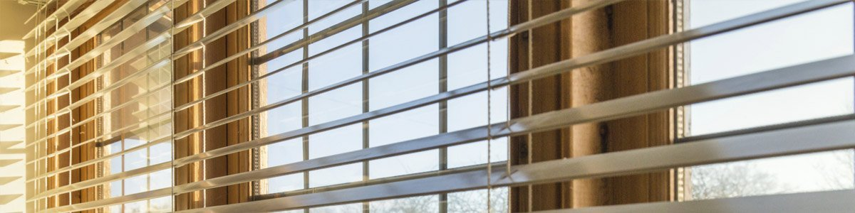 elegant blinds and awnings  creamish blinds on window
