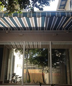 elegant blinds and awnings striped awnings near glass door