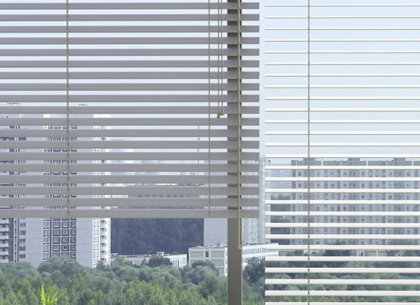 elegant blinds and awnings city view through blinds