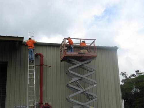 Professional staff of A-Plus Seamless Raingutters INC installing commercial gutters
