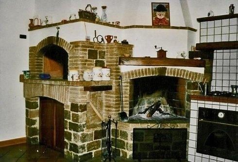 rivestimento in pietra per camino e forno a legna