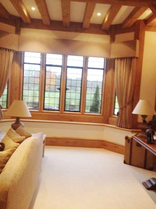 Cream window curtains with matching pelmet