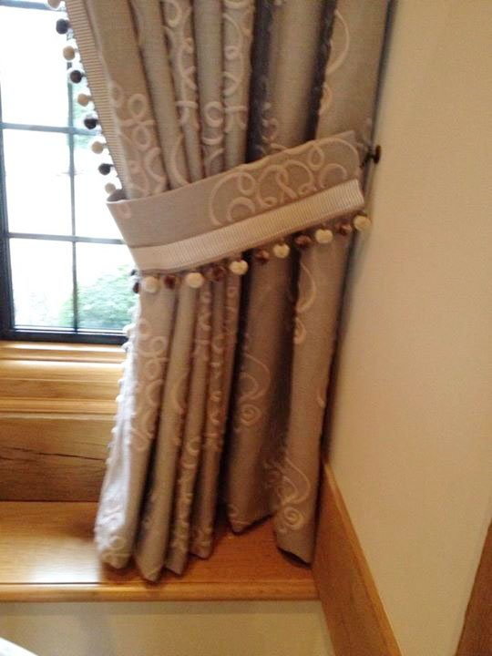 Cream embellished curtains with tie back