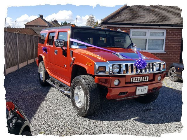 orange coloured Baby Hummer Limo