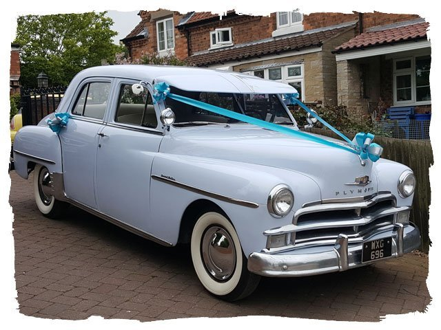 blue coloured 1950 Plymouth Special Deluxe