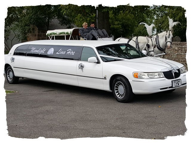 "white coloured Lincoln Towncar 120"" super stretch limousine"