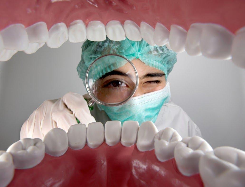 dentist inspecting teeth