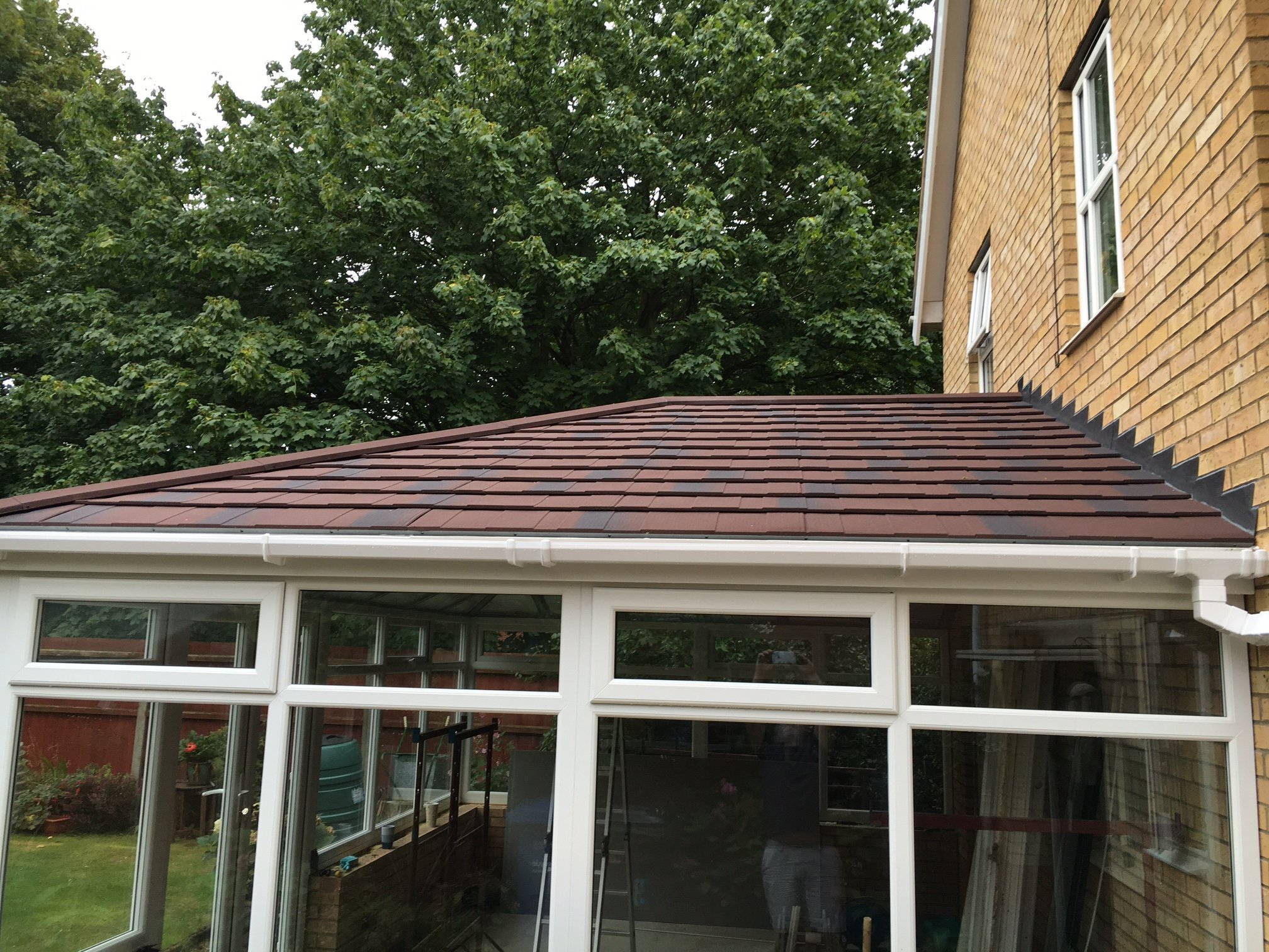leka_warm_conservatory_roof_replacement_tapco_slate__side_composite_door_sales_bolton_bury