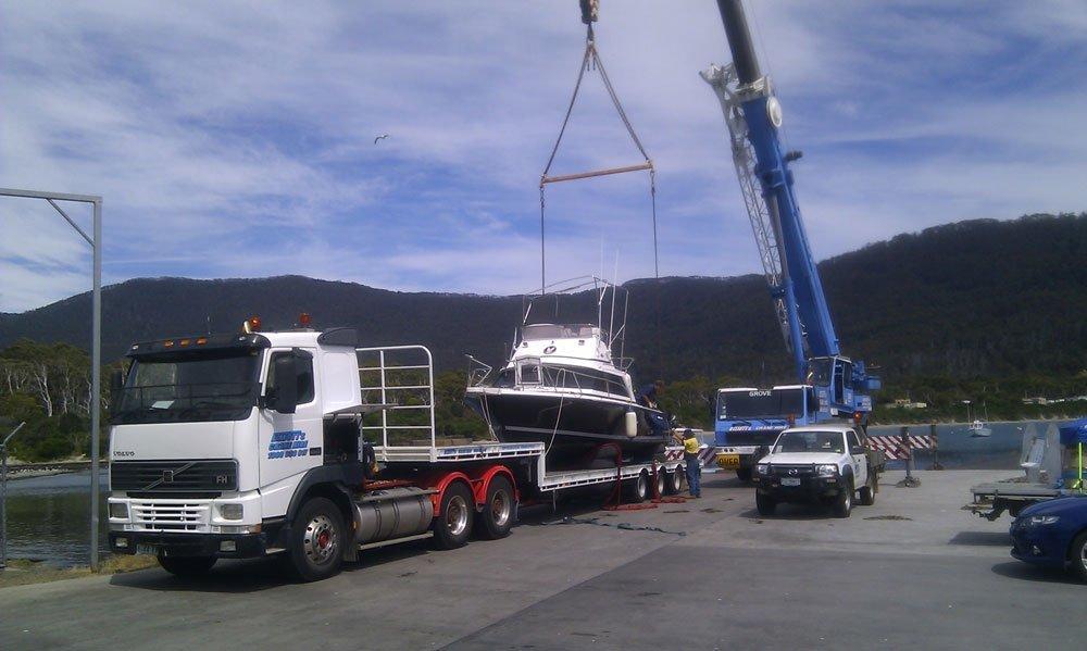 crane lifting boat