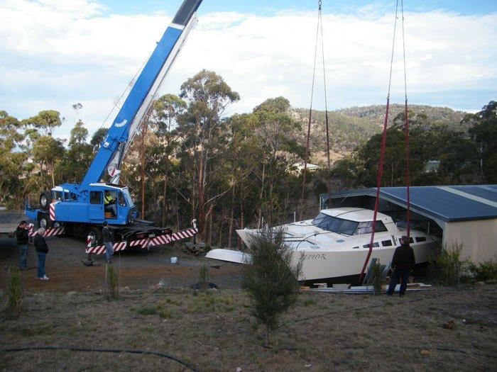 crane lifting a boat
