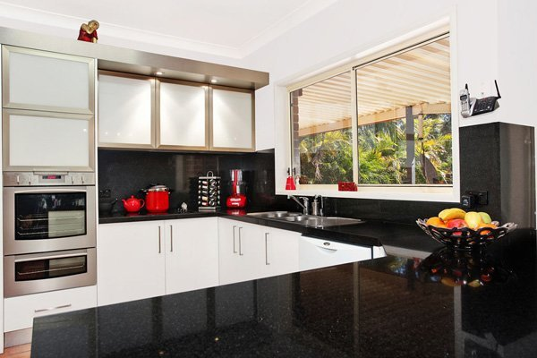 modern kitchen with black and red accents