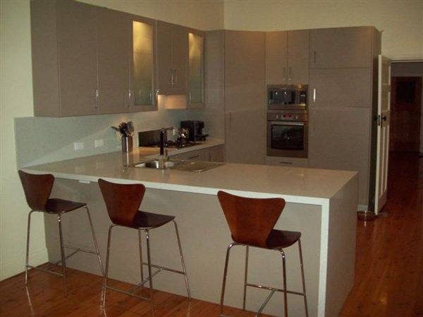 kitchen after renovation with red accents
