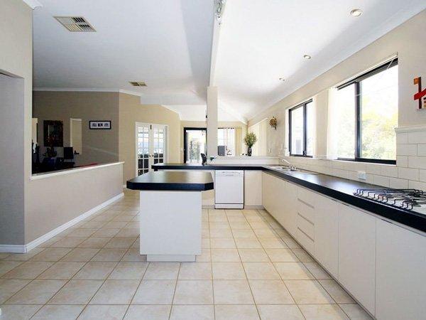 kitchen before renovation with linoleum floors