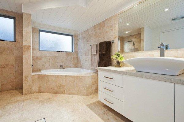bathroom with granite flooring and countertops