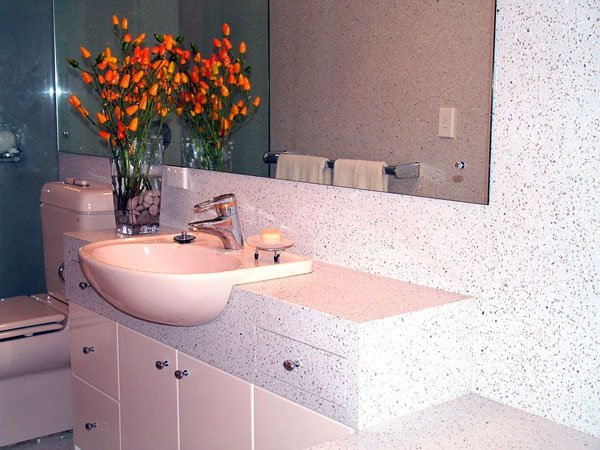 modern bathroom with flowers on counter