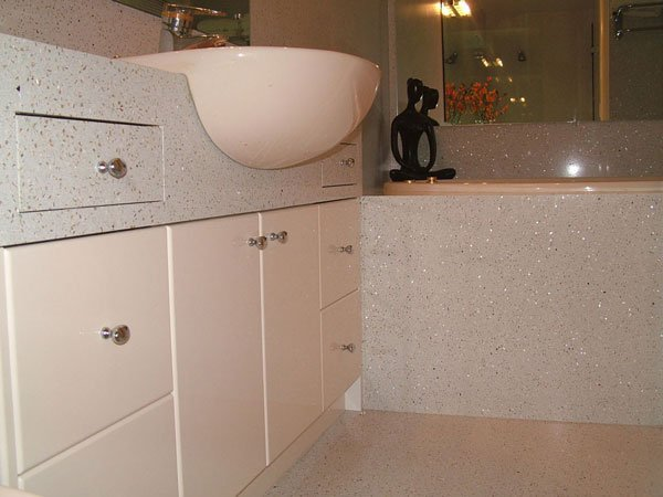 bathroom with white cupboards