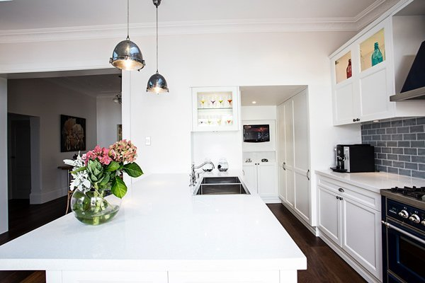 kitchen with countertop and flowers on counter