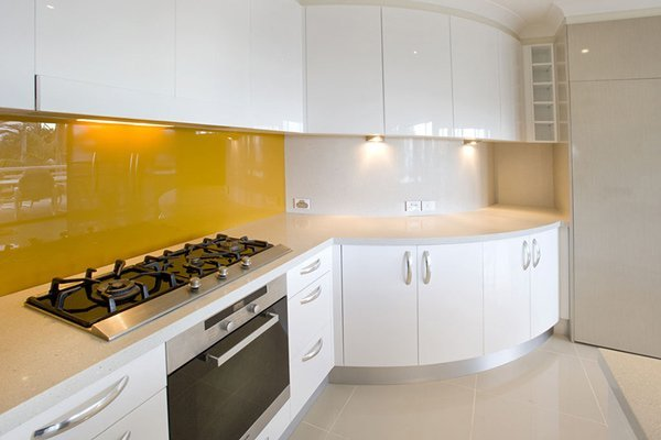kitchen with granite countertop and yellow accents