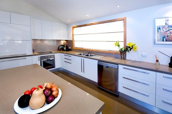 kitchen with white cupboards and granite countertops