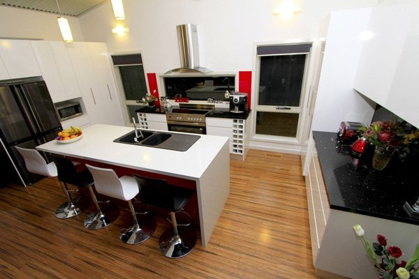 kitchen with wood floors and granite countertops