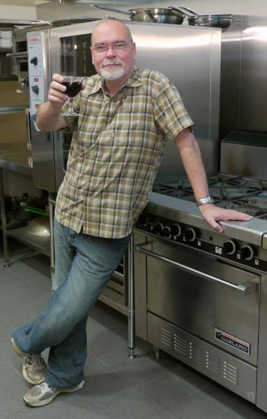 John Hart in kitchen with new technology
