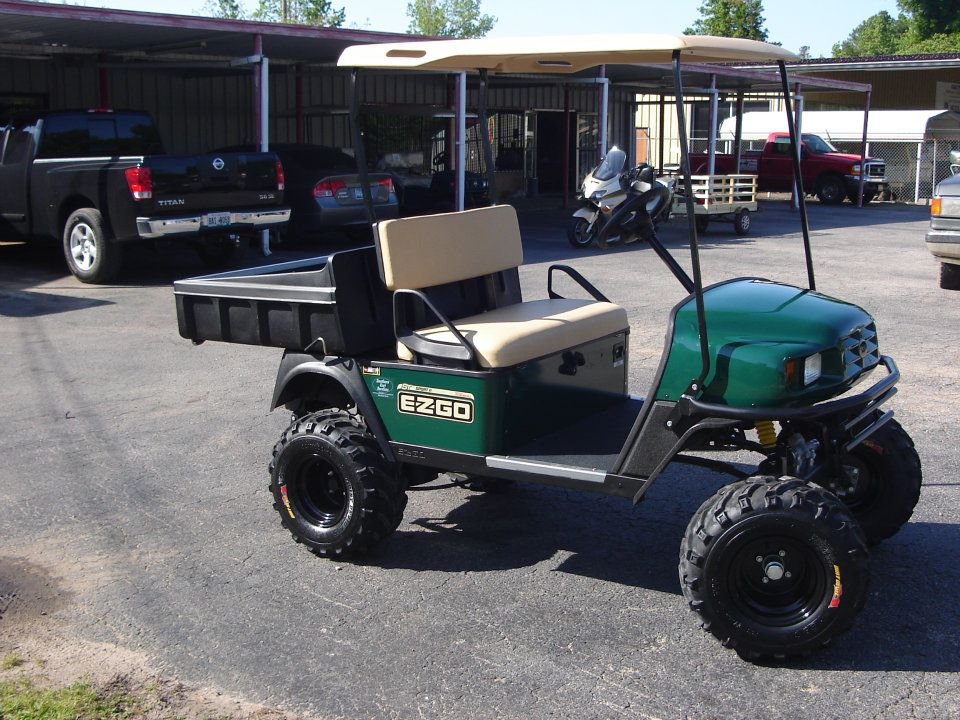 Couple in one of our golf carts in La Grange, GA
