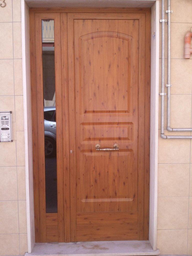 realizzazione di porte per esterni