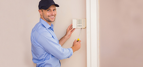 Professional installing the alarm system