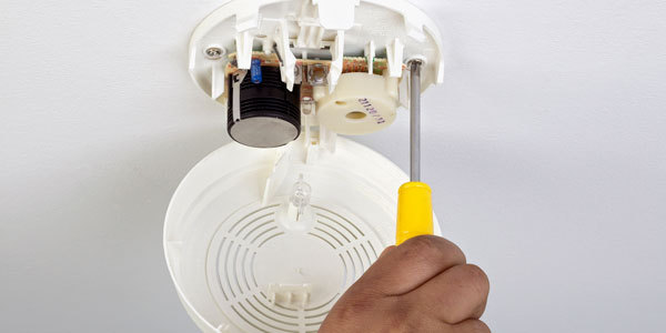 Expert installing the fire protection system