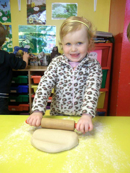 girl playing with dough