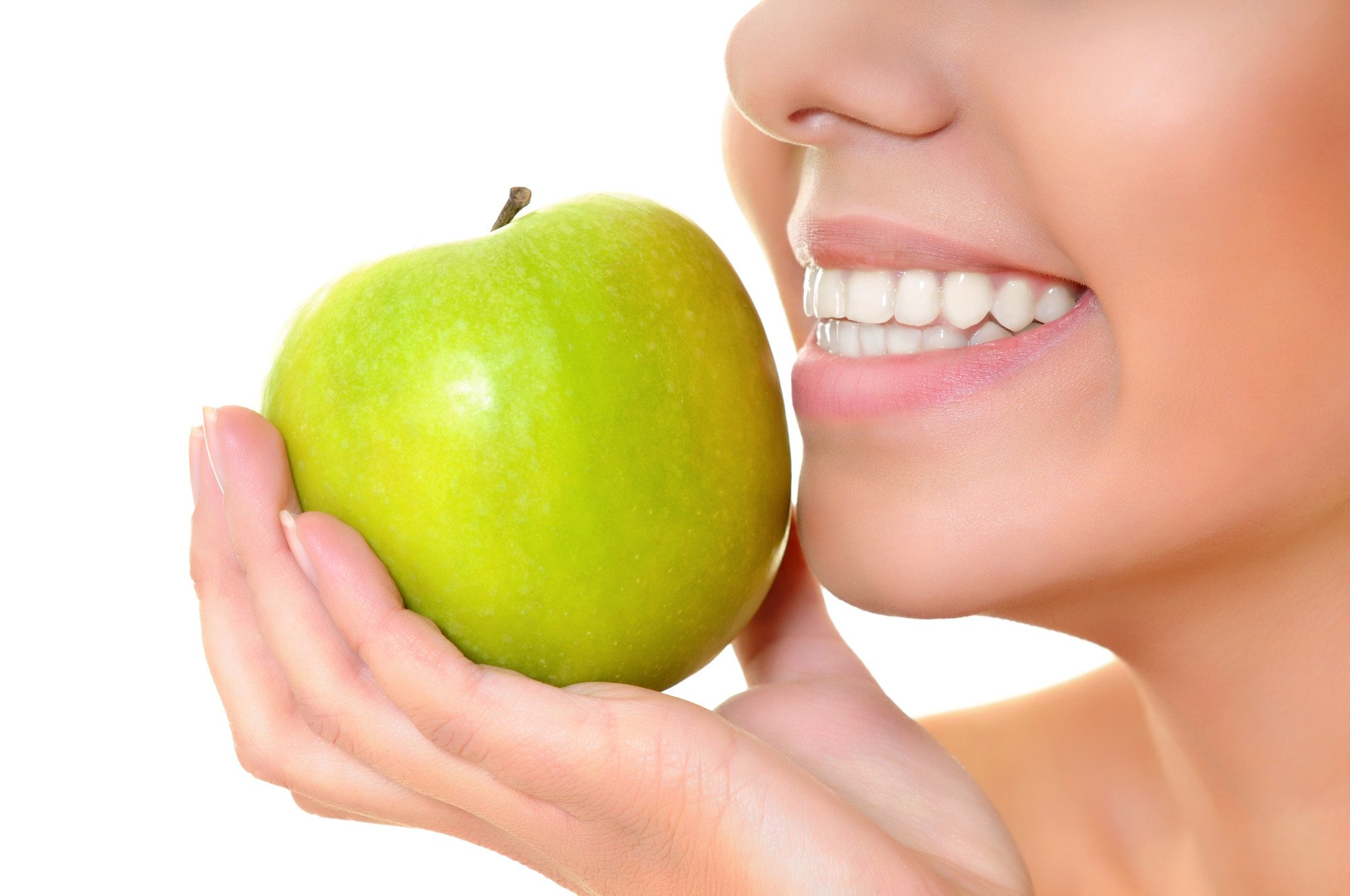 A girl holding an apple