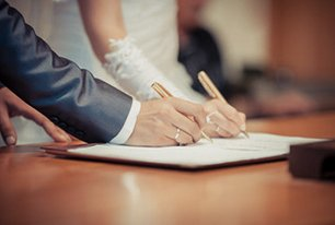 couple signing agreement