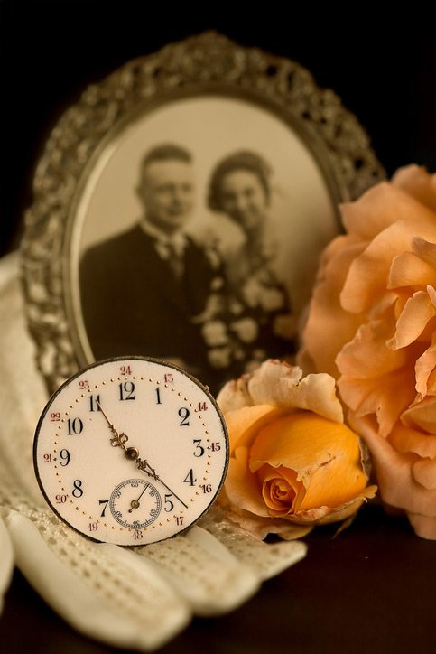 frame pocket watch and flowers