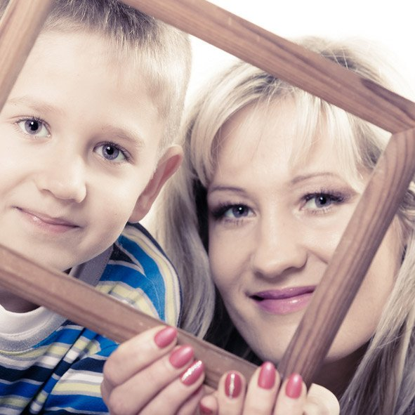 woman and boy looking through picture frame