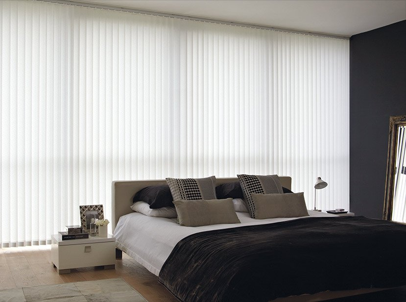 white vertical blinds in bedroom
