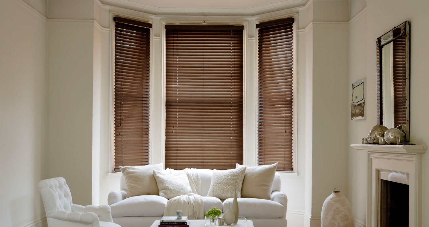 brown shutters in white living area
