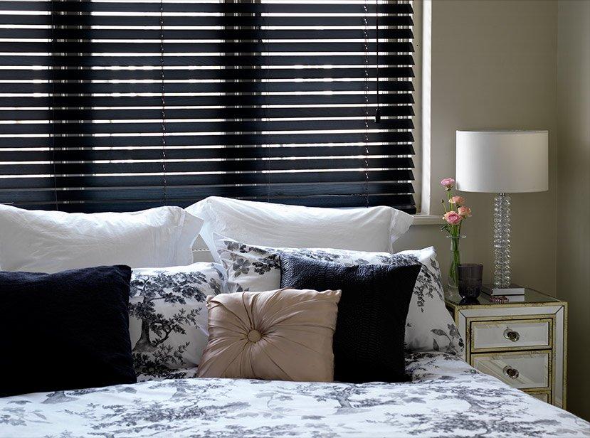 dark venetian blinds in bedroom