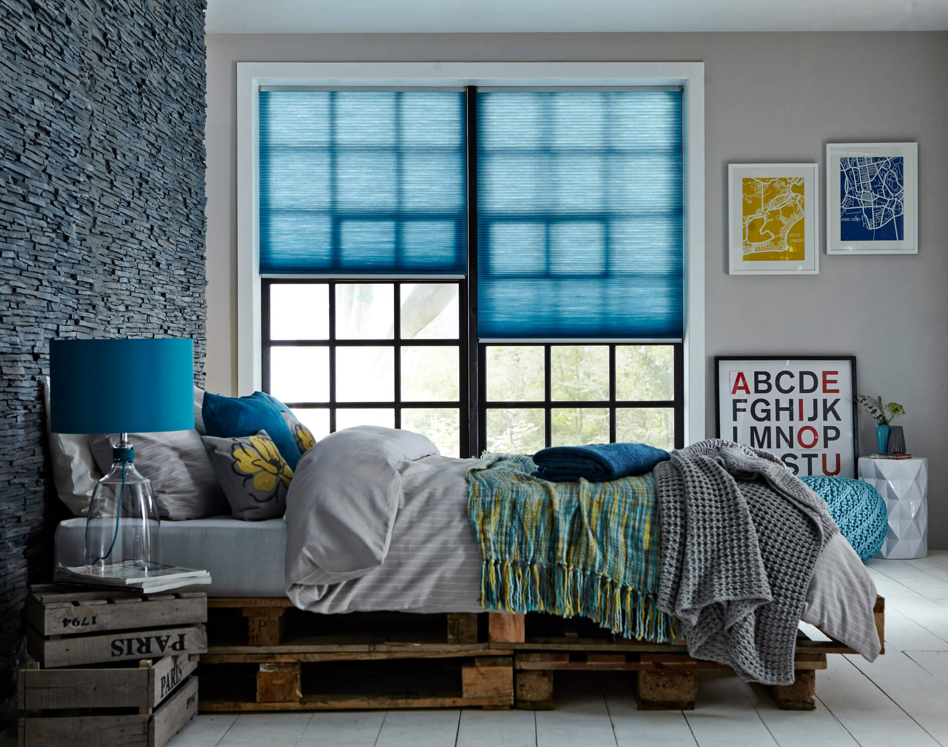 blue roller blinds in bedroom