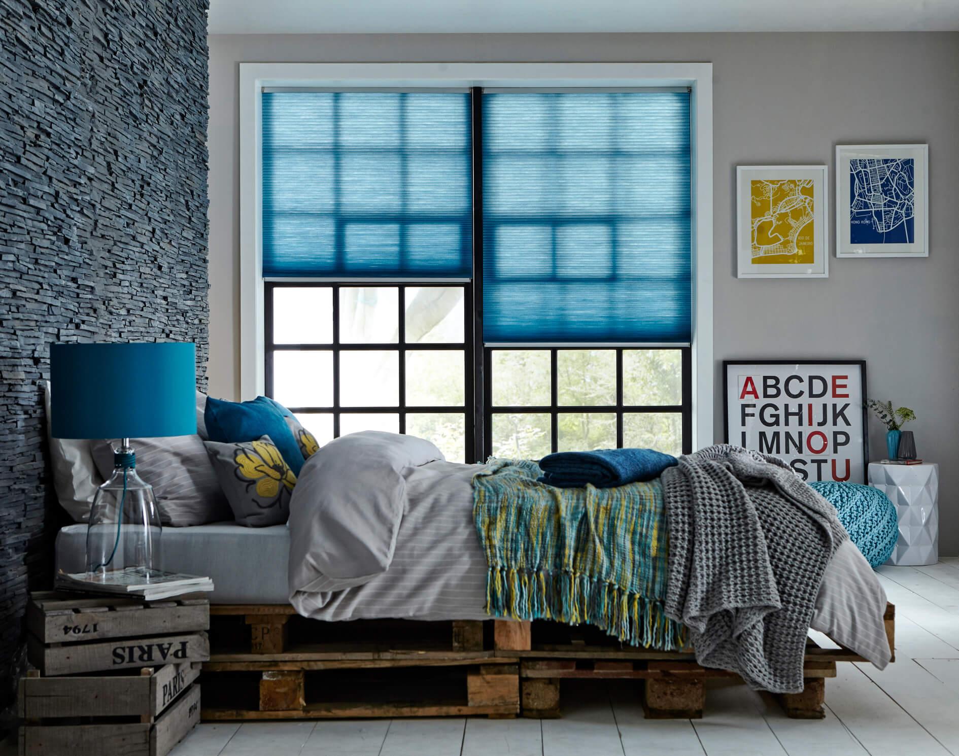 blue roller blinds in bedroom