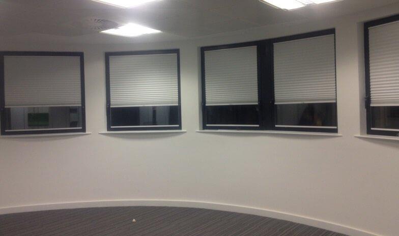 white roller blinds in room