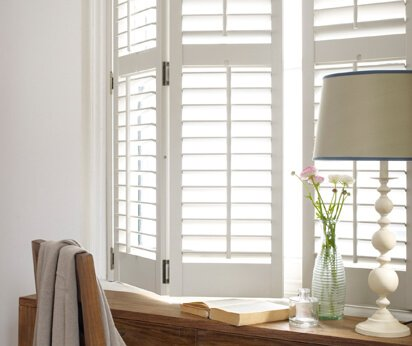 white shutters by desk