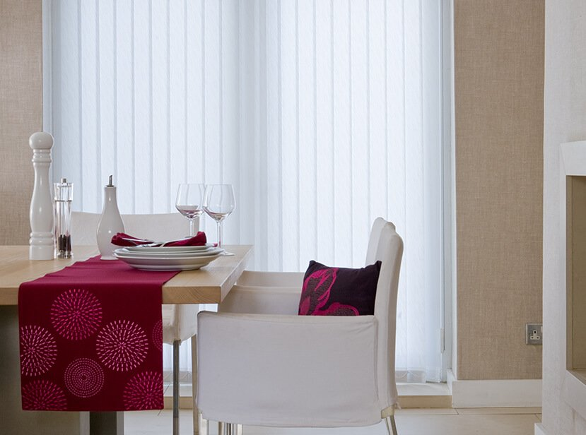 white vertical blinds in dining room